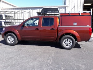 Nissan Frontier ARE DCU aluminum work truck topper